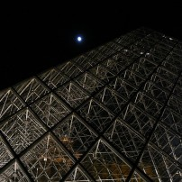 The Louvre pyramid at night.